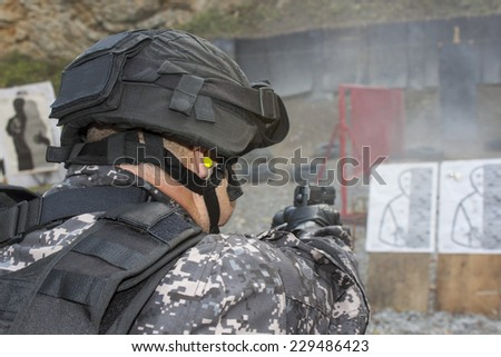Special anti-terrorist squad, coached at the shooting range - stock photo