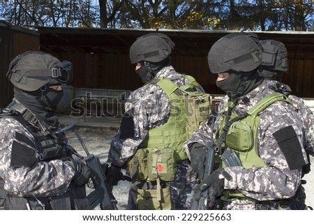 Special anti-terrorist squad, coached at the shooting range, consultation - stock photo
