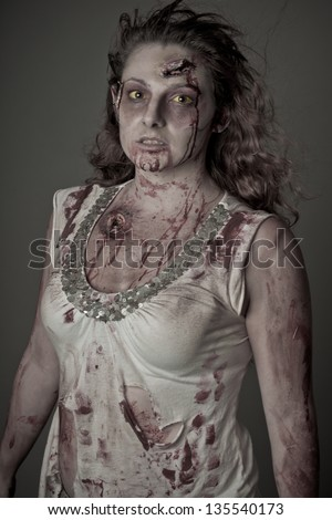 Special effects artist creates Zombie woman eyes looking at camera - stock photo