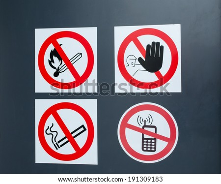 Special fire warning signs symbol on gas factory door. High explosion risk zone.  - stock photo