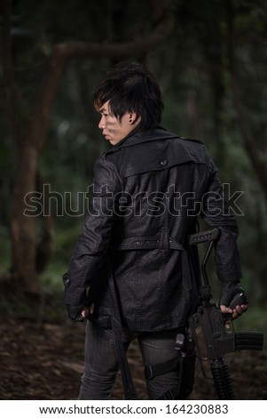 Special force with the gun in the jungle - stock photo