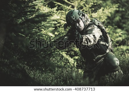 Special Forces Soldier. Camouflaged Marine Soldier Shooting Assault Rifle. Army Military Mission Concept Photo. - stock photo