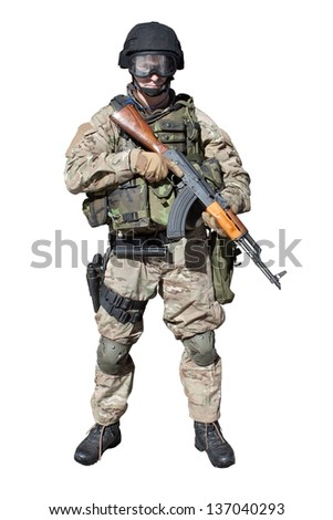 Special Forces soldier, with favorite weapon of terrorists, assault rifle AK-47, isolated on white - stock photo