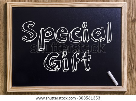 Special Gift - New chalkboard with 3D outlined text - on wood - stock photo
