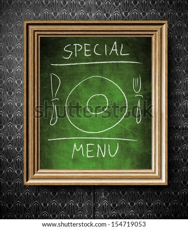 Special menu chalkboard in old wooden frame on vintage wall - stock photo