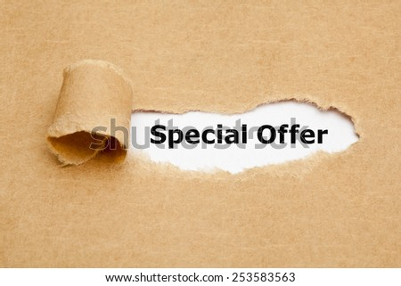 Special Offer appearing behind torn brown paper. - stock photo