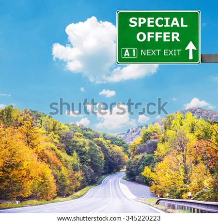 SPECIAL OFFER  road sign against clear blue sky - stock photo