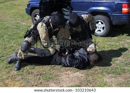special police commandos arrest a terrorist - stock photo