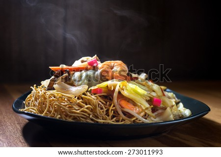 Special seafood yakisoba - Japanese stir fried noodle with shrimp , squid & vegetable - stock photo