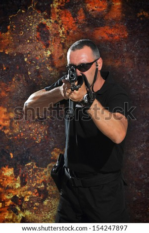 special tactics man holding up his weapon - stock photo