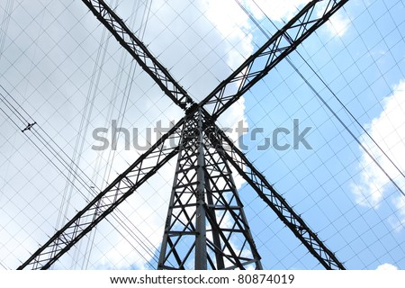 Special type of power transmission tower with cables - stock photo