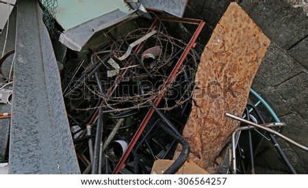 special waste dump with old rusty iron pieces - stock photo