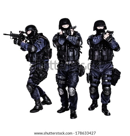 Special weapons and tactics (SWAT) team in action - stock photo