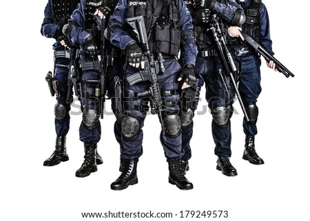 Special weapons and tactics (SWAT) team officers with guns - stock photo