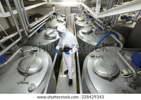 specialist in plant controlling technological process - stock photo