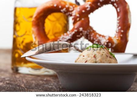 speckknoedel, a tyrolean dumpling in broth  - stock photo