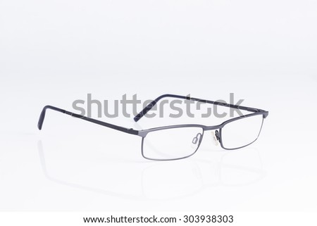 Spectacles on white background for concepts of vision and intelligence - stock photo