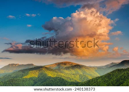 Spectacular cloud formation over Velka Fatra mountains in Slovakia during sunset - stock photo