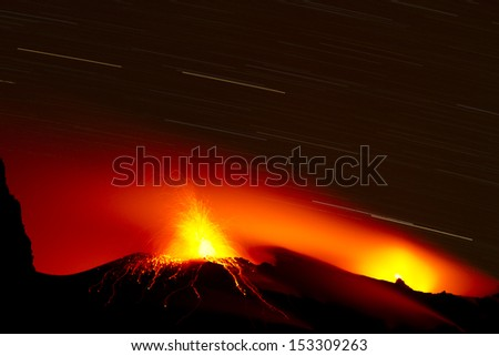 spectacular eruption of volcano - stock photo