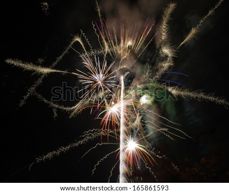 Spectacular fireworks against a black, night sky - stock photo