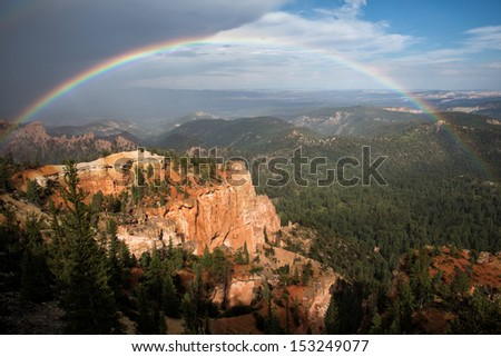spectacular full rainbow in Bryce Canyon National Park, southwestern Utah, a unique place on Earth. Its large collection of delicate, rocky, colorful formations are called hoodoos. - stock photo