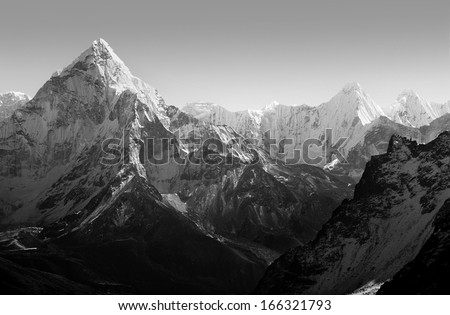 Spectacular mountain scenery on the Mount Everest Base Camp trek through the Himalaya, Nepal in stunning black and white - stock photo