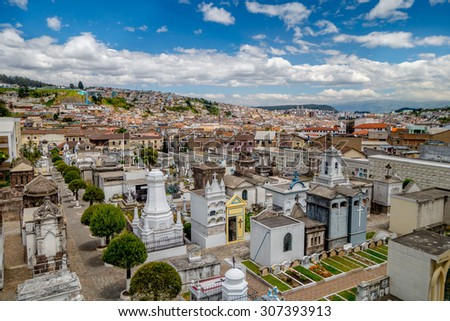 Spectacular overview of cemetary San Diego showing typical catholic graves with large gravestones and old city background. - stock photo