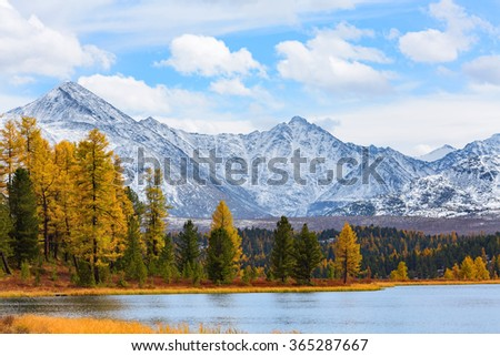 Spectacular panoramic landscape with snow capped mountains, forest and lake. Autumn time. Lake Kidelyu, Ulaganskiy pass, Altai, Siberia, Russia - stock photo