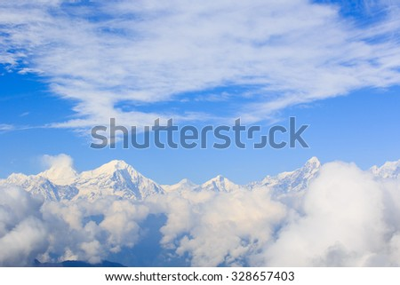 Spectacular snow mountain scenery and rolling clouds - stock photo