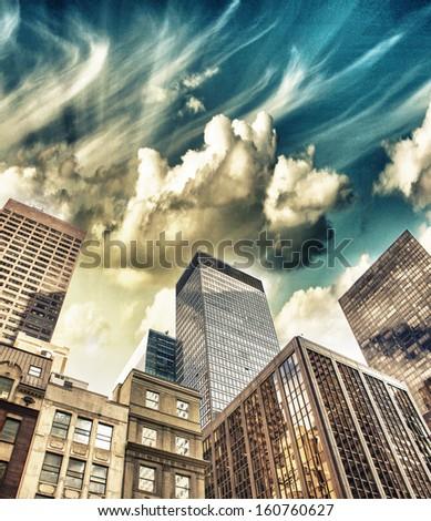 Spectacular street upward view of Manhattan Skyscrapers - New York City. - stock photo