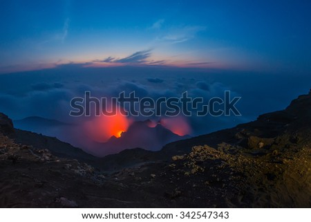 Spectacular Stromboli volcano eruption during the night - stock photo