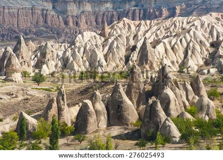 Spectacular teeth-like rock formation and old christian caves near Goreme, Cappadocia, Turkey - stock photo