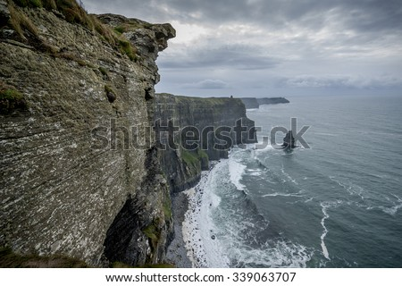 Spectacular vertical wall of cliffs of Moher on the west coast of Ireland - stock photo