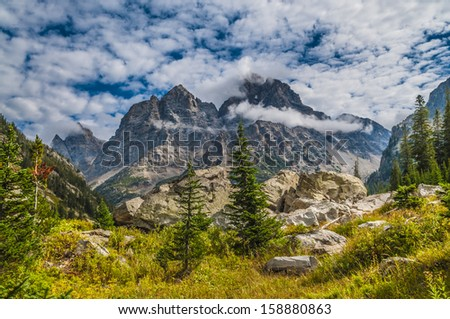 Spectacular View of the Grand Teton Peaks from the Cascade Canyon trail - stock photo