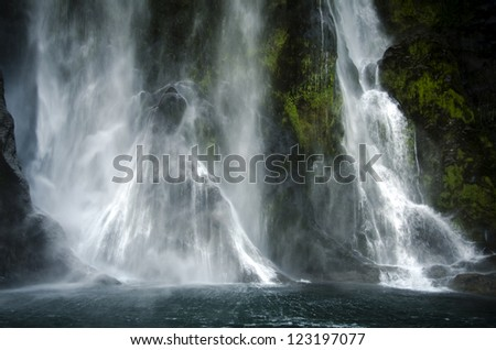 Spectacular waterfall in Milford Sound, New Zealand. - stock photo