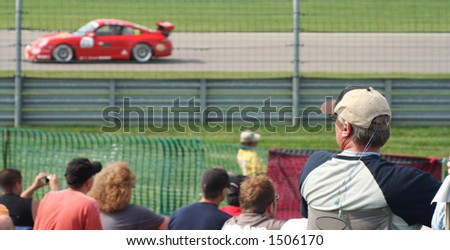spectador watching race car in Indianapolis 2006 - stock photo