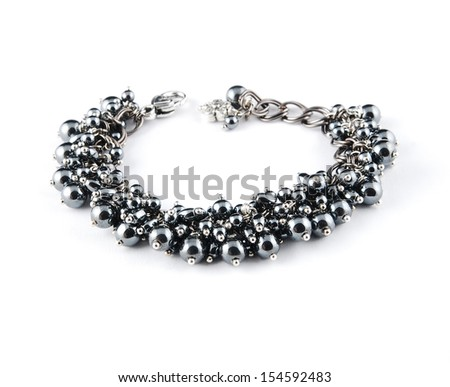 Specular bracelet on white - stock photo