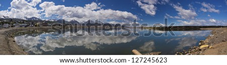 Specular reflection of the cityscape of Ushuaia in  Tierra del Fuego, Argentina - stock photo