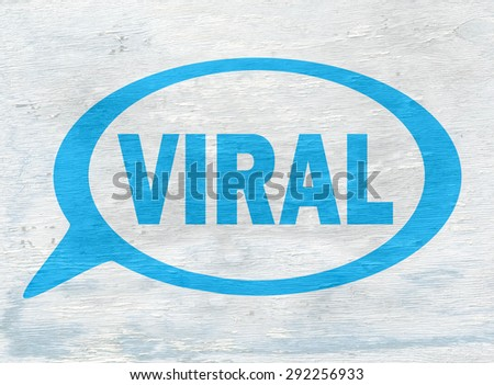 speech bubble with viral message on wood grain texture - stock photo