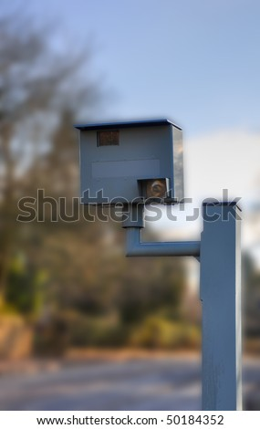 Speed camera with blurred background - stock photo