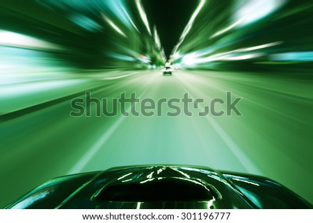 Speed driving car in the night city on the road - stock photo