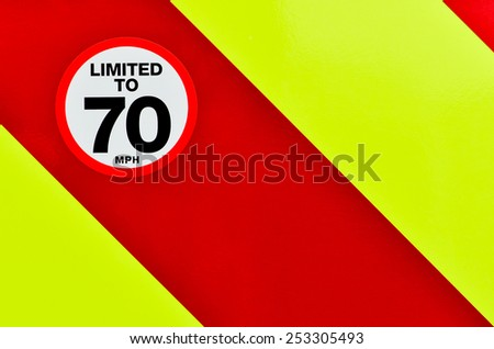 Speed limited sign on the back of a vehicle with high visibility - stock photo