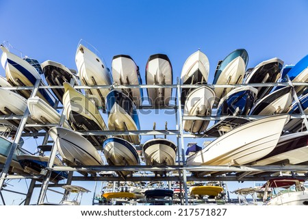 speed motor boats are stapled in a garage system in the prestigious harbor in Miami - stock photo