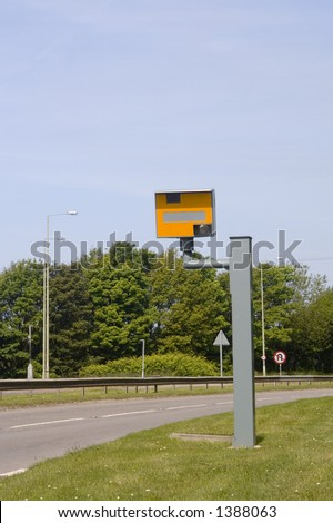 Speed restrictions, signs and camera on busy dual carriageway in Wales, UK. - stock photo