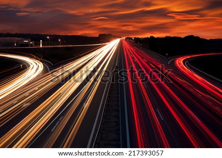 Speed Traffic - light trails on motorway highway at night,  long exposure abstract urban background - stock photo