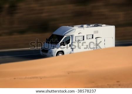 speed white van on troad - stock photo