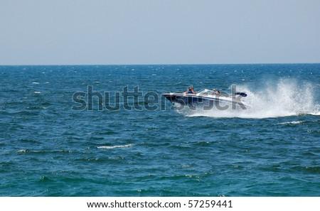 Speedboat fun on Lake Michigan - stock photo