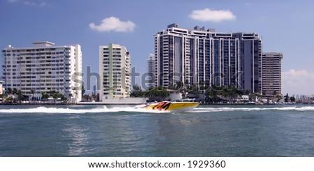 Speedboat in front of the Miami Beach Skyline - stock photo
