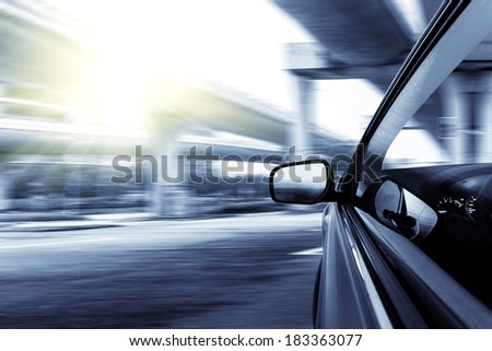 speeding car go through the overpass bridge, low angle view at shanghai china. - stock photo