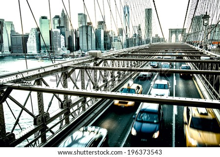 Speeding cars on Brooklyn Bridge. Urban living and transportation concept - stock photo